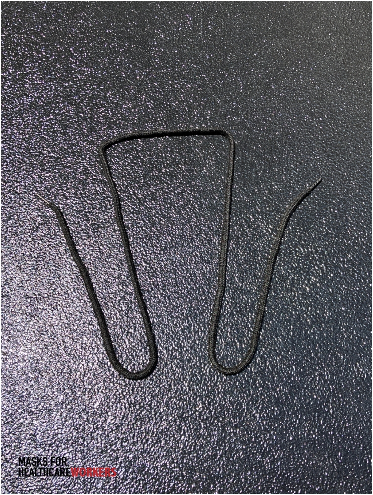 layout for shoelace prior to attaching to face mask.