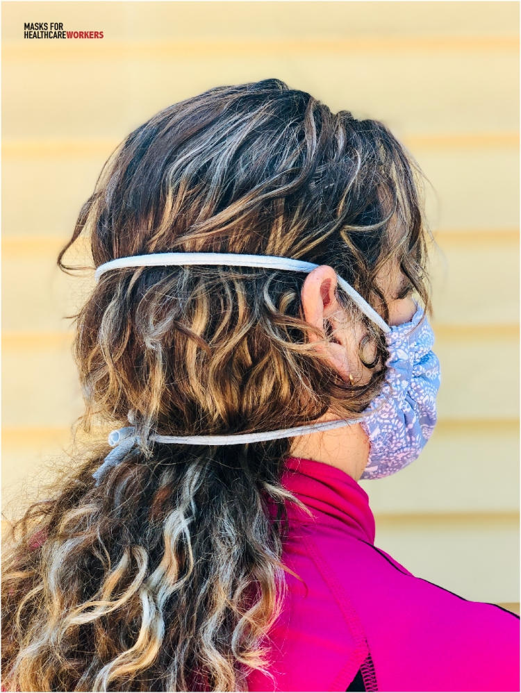 view of the back of woman's head using a diy t-shirt tie with mask at Masks For Healthcare Workers.